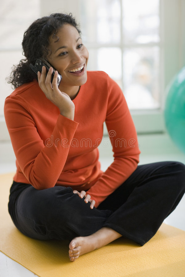 Pretty black woman on cell phone stock photos