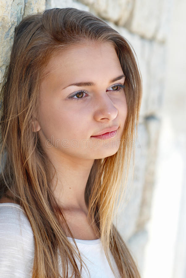 Pretty blond girl outdoors royalty free stock photo