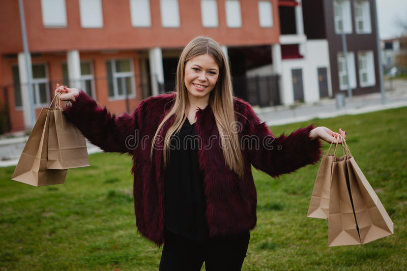 Pretty blond girl shopping stock photography