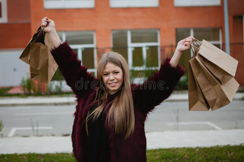 Pretty blond girl shopping stock images