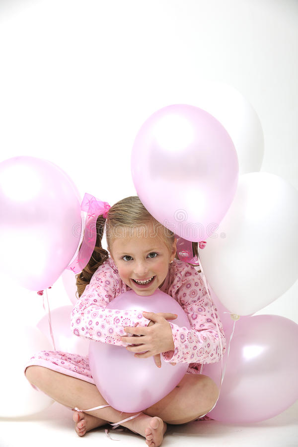 Free Pretty Blond Girl Sitting Between Pink Balloons Stock Photos - 15167093