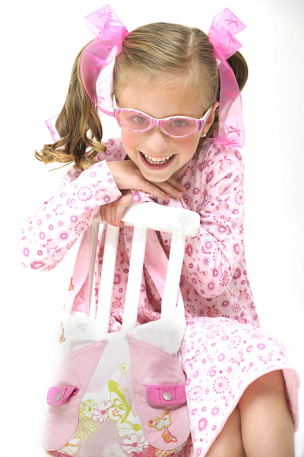 Free Pretty Blond Girl With Pink Glasses Sitting On A C Stock Photography - 15167072