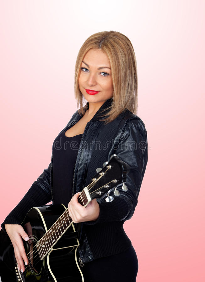 Pretty blond musician with a guitar stock photos