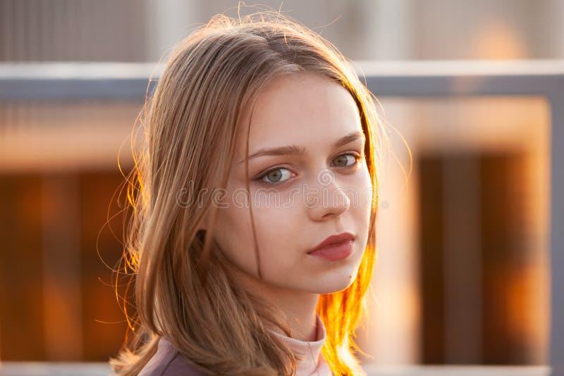 Pretty blond teenage girl, close-up stock photo