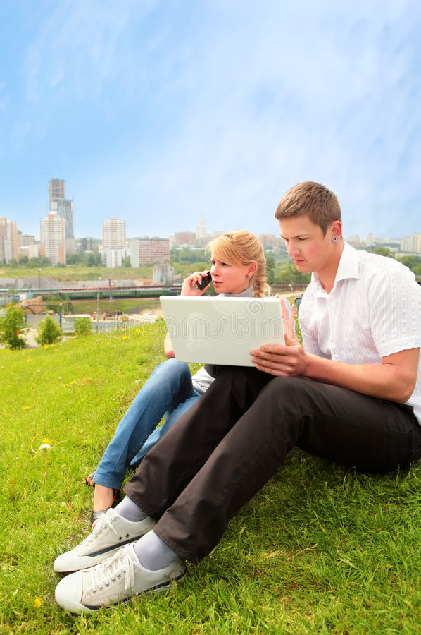 Pretty blond, yong man and laptop royalty free stock photos
