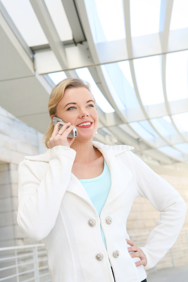 Pretty Blonde Business Woman on Cell Phone royalty free stock photos