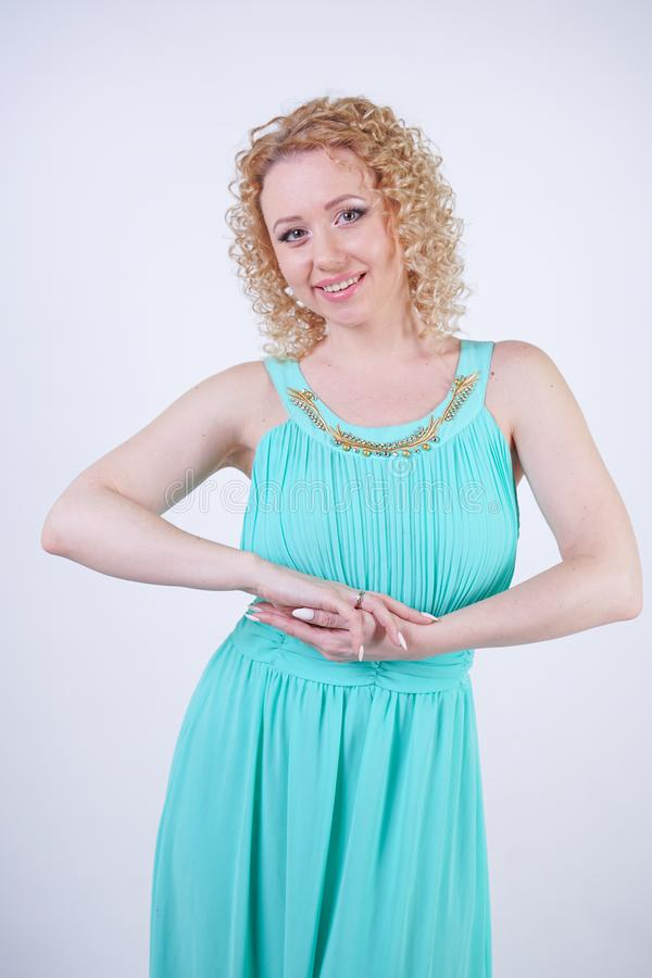 Pretty blonde caucasian woman wearing long blue fashion summer dress on white background stock image