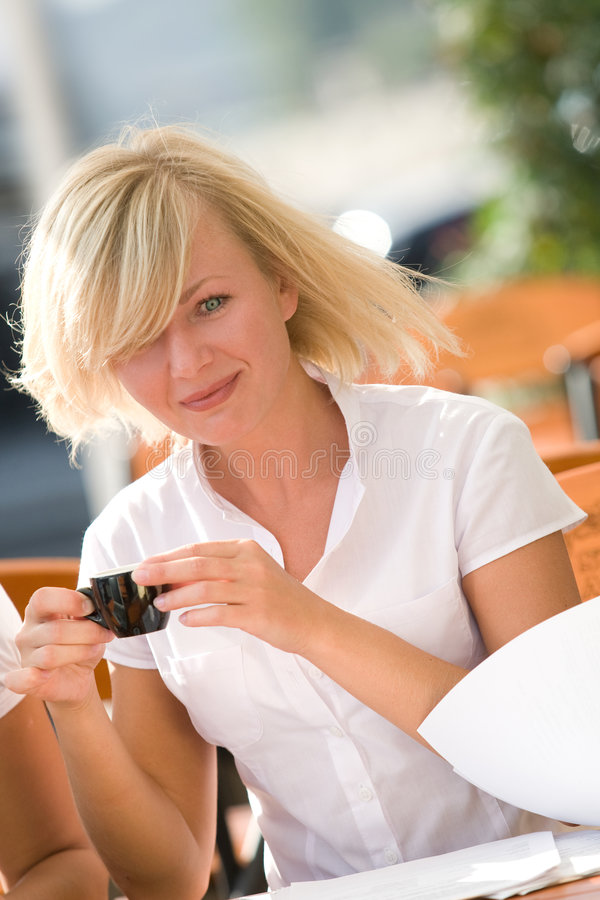 Free Pretty Blonde Drinking Coffee Stock Photography - 6942552