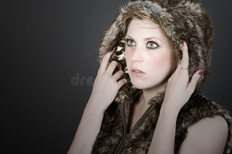 Pretty Blonde Girl in Hooded Fur Top royalty free stock image