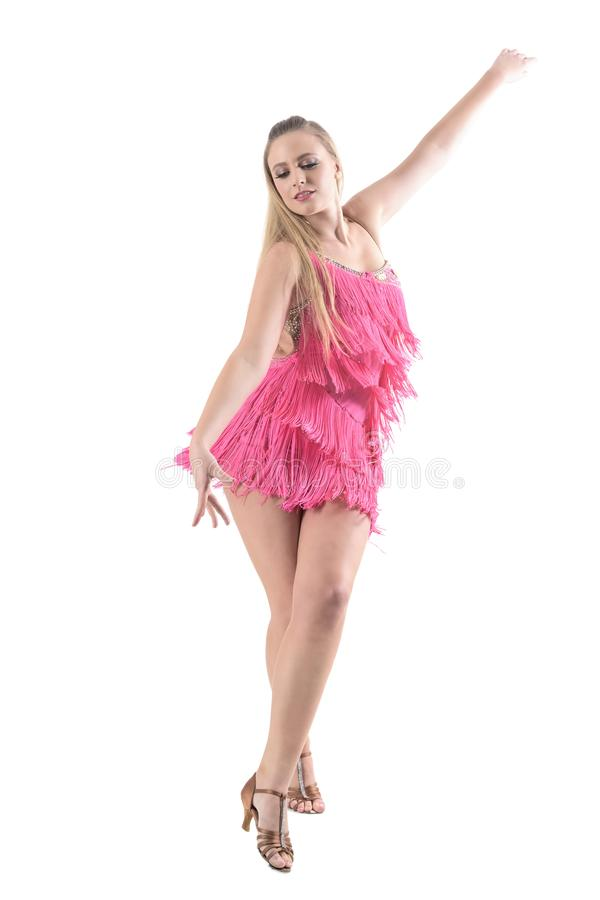 Pretty blonde hair samba dancer with arm spread looking down. royalty free stock photography