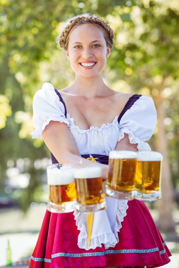 Pretty blonde holding beers royalty free stock images