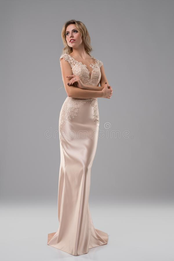 Pretty blonde in luxurious evening dress shot royalty free stock photos