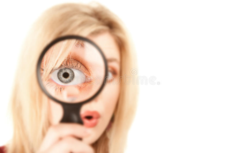 Pretty Blonde Woman with Magnifying Glass. Pretty Young Blonde Woman Looking Through Magnifying Glass royalty free stock photos