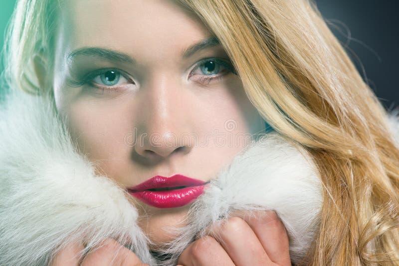 Pretty blonde woman in winter coat. Pretty blonde woman in a warm winter coat royalty free stock images