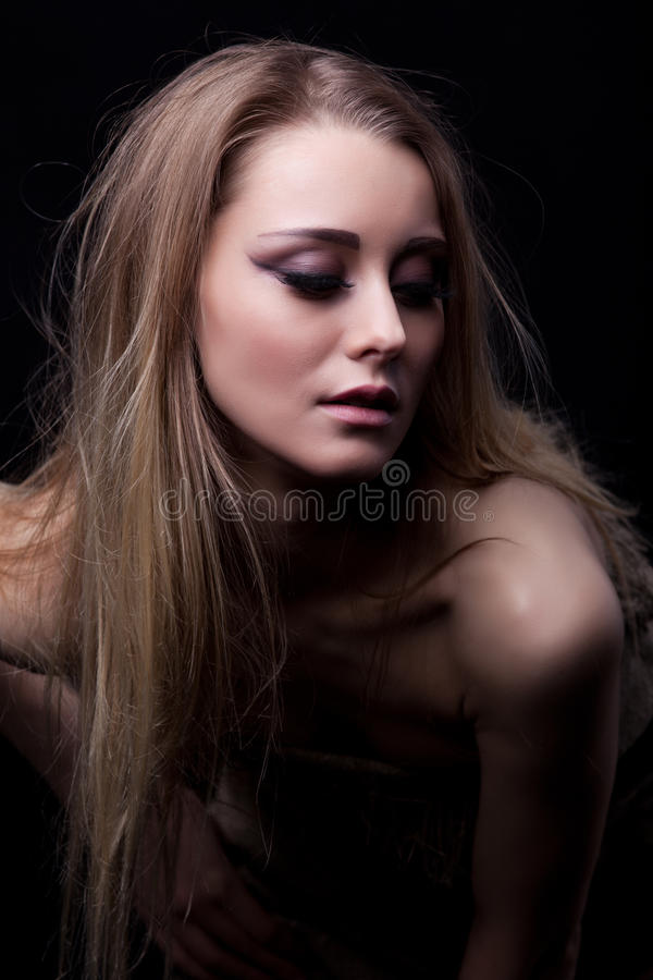 Pretty blonde young woman stock image