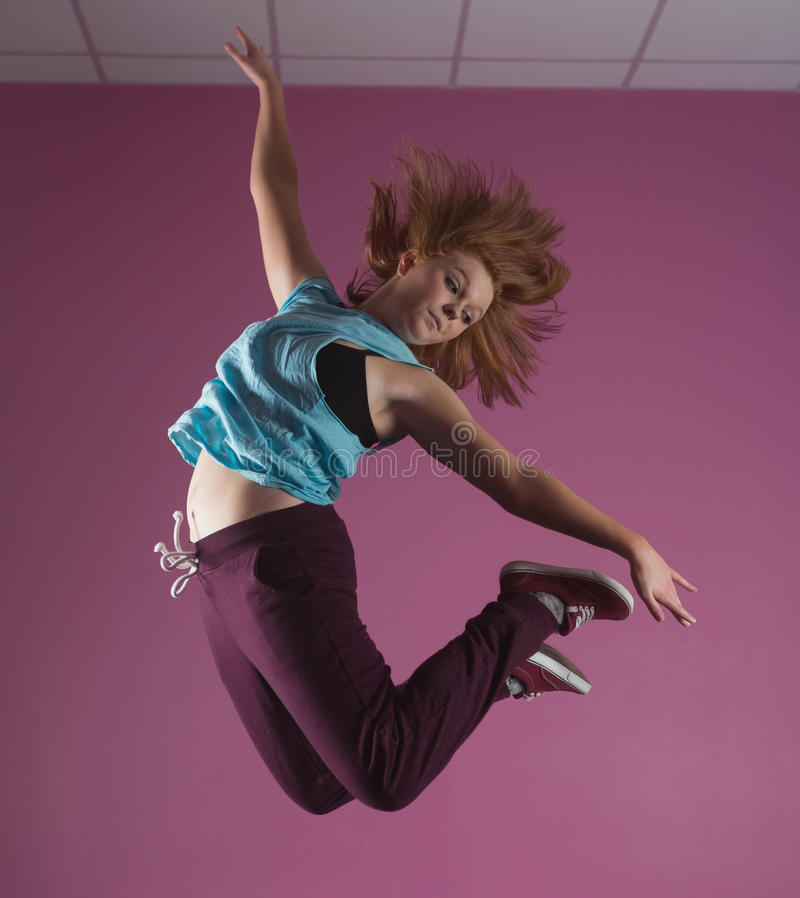 Pretty break dancer jumping up. In the dance studio royalty free stock photos