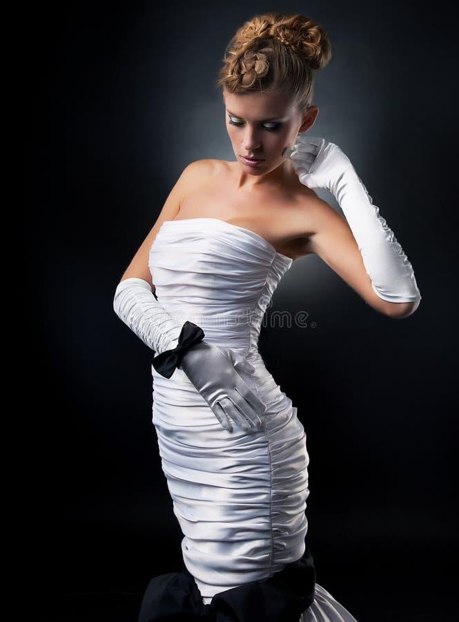 Pretty bride blonde woman in fashion wedding dress royalty free stock image