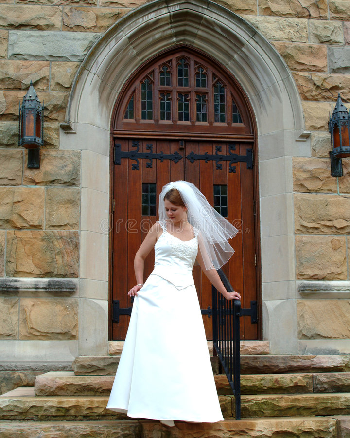 Pretty Bride on Stone Steps royalty free stock photography