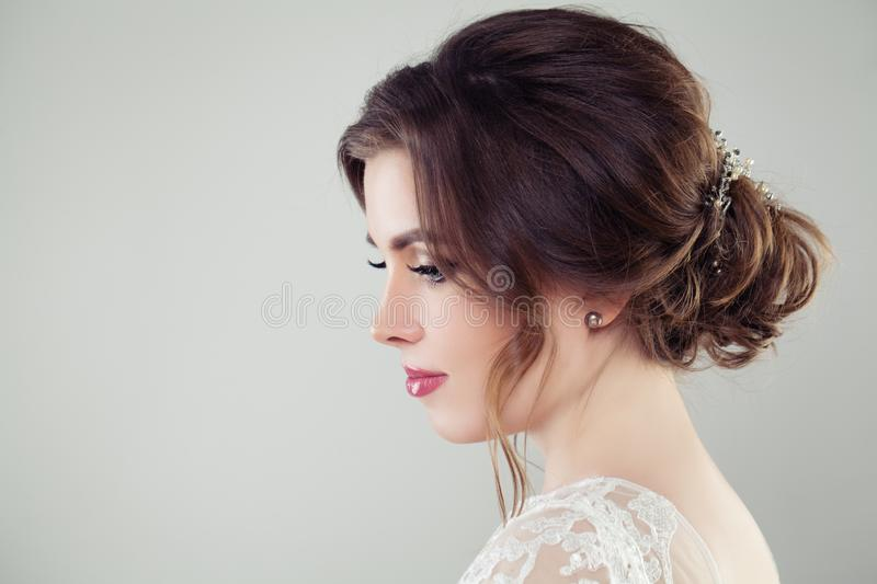 Pretty bride woman with bridal hair. Updo haircut with pearls hairdeco, face closeup royalty free stock images