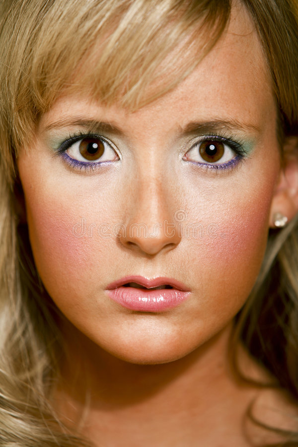 Pretty brown eyed blonde girl stock photo
