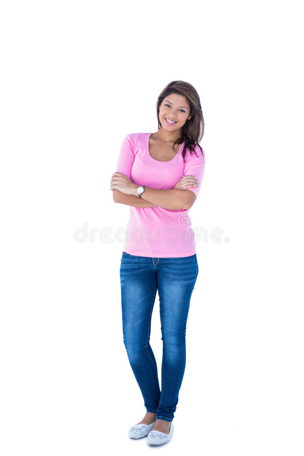 Pretty brunette with arms crossed looking at camera. On white background royalty free stock photo