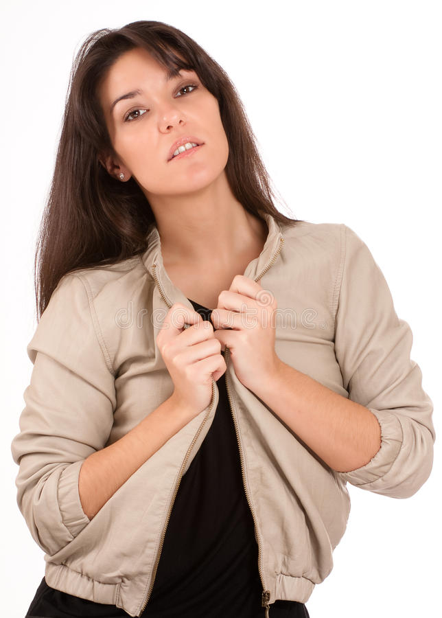 Download Pretty Brunette Arranging Her Jacket Stock Photos - Image: 27638723