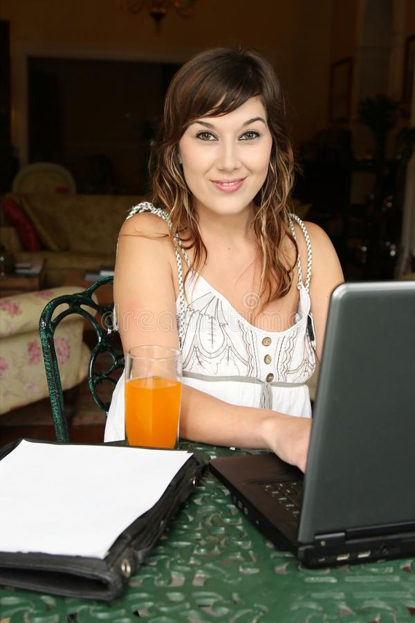 Pretty Brunette with Computer stock photo