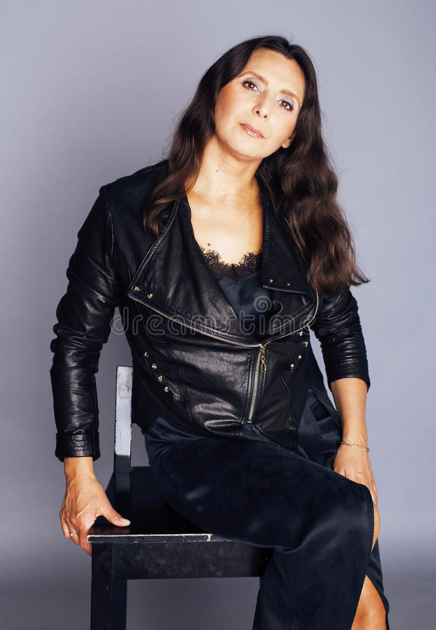 pretty brunette confident stylish real mature woman sitting on c