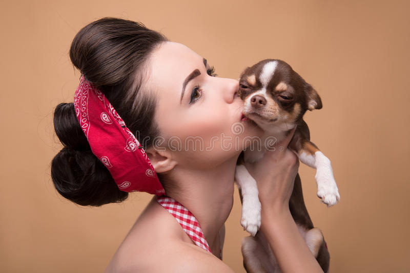 Pretty brunette girl in retro style stock image