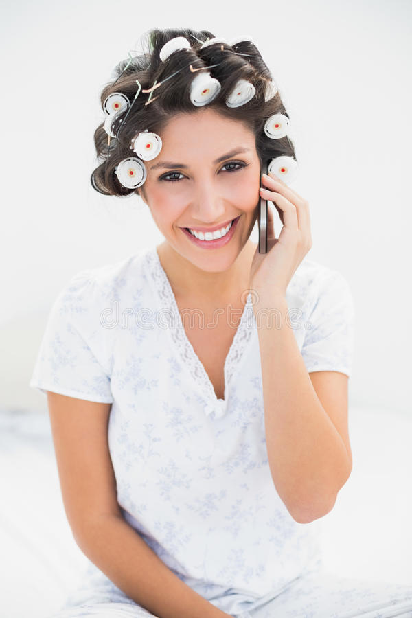 Download Pretty Brunette In Hair Rollers On The Phone On Bed Stock Image - Image of household, abode: 33050329