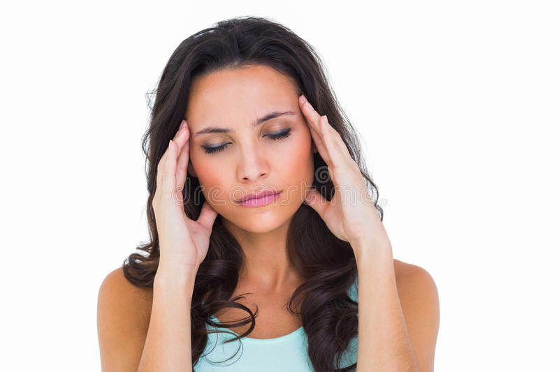 Pretty brunette with a headache stock images