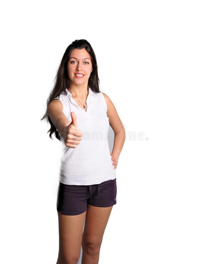 Pretty brunette isolated on white gives thumbs up royalty free stock photo