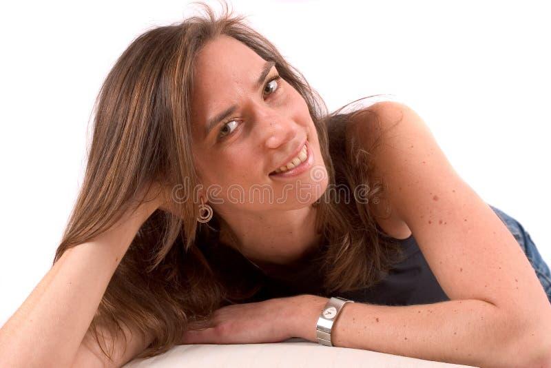 Pretty brunette lying royalty free stock photos
