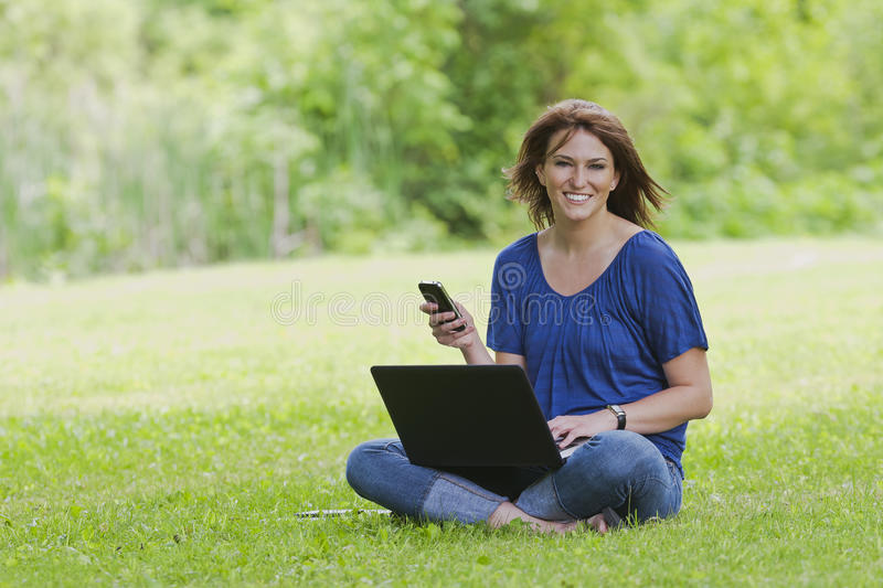 Pretty Brunette Model On Computer royalty free stock image