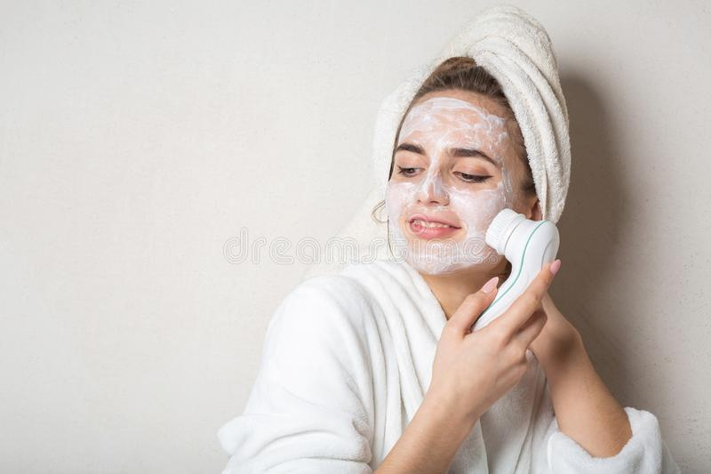 Pretty brunette model posing with moisturizing cream mask and face cleaner. Empty space. Pretty brunette woman posing with moisturizing cream mask and face stock photo