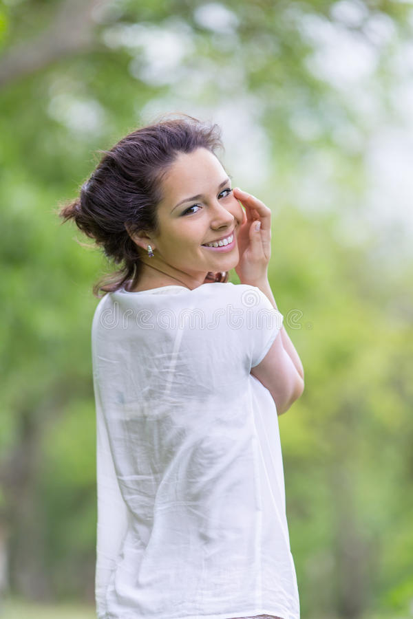 Download Pretty Brunette Posing Outdoors Stock Photo - Image: 83707141