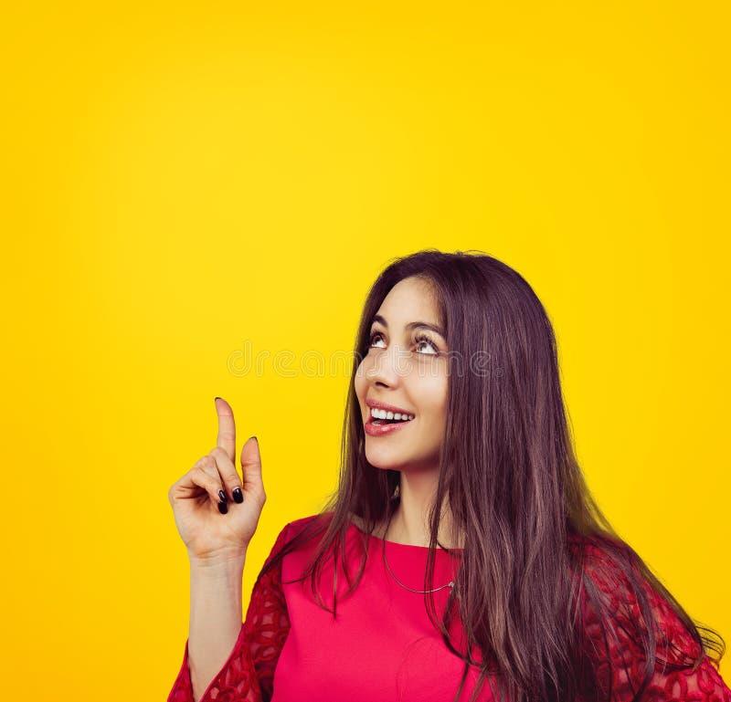 Happy young woman having idea stock photos