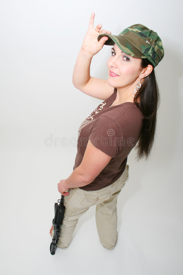 Pretty Brunette with Rifle royalty free stock photography