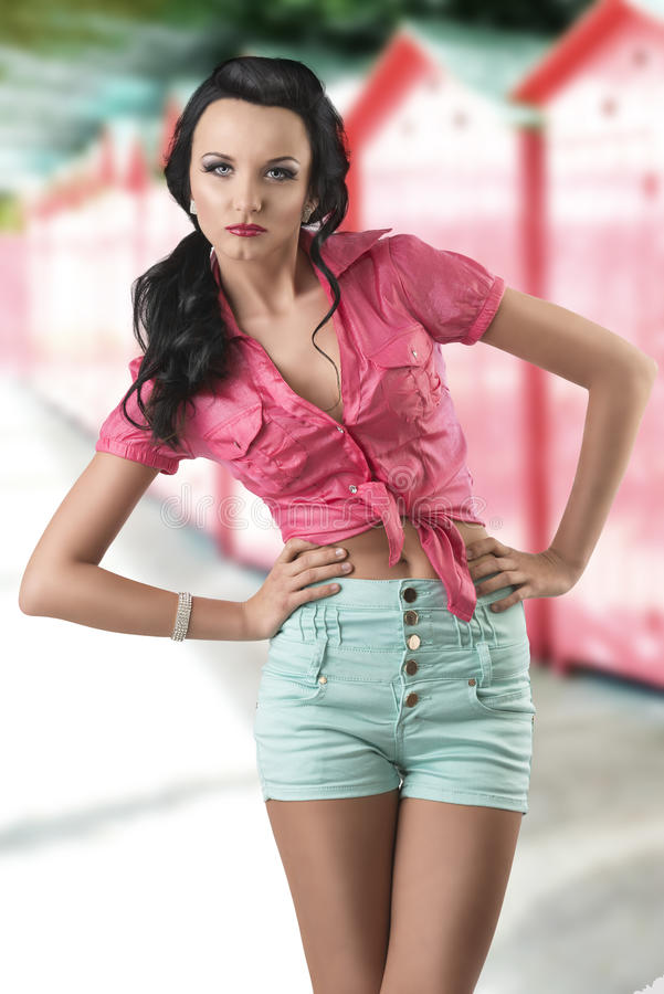 Download Pretty Brunette With Shorts With Hands On The Hips Stock Photo - Image: 25733438