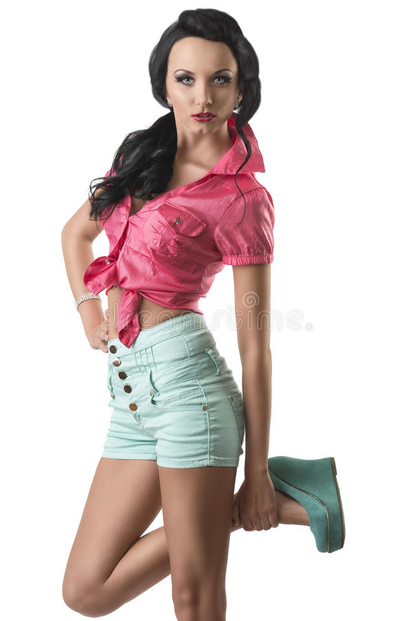 Pretty Brunette With Shorts She Touches Her Ankle Royalty Free Stock Photography