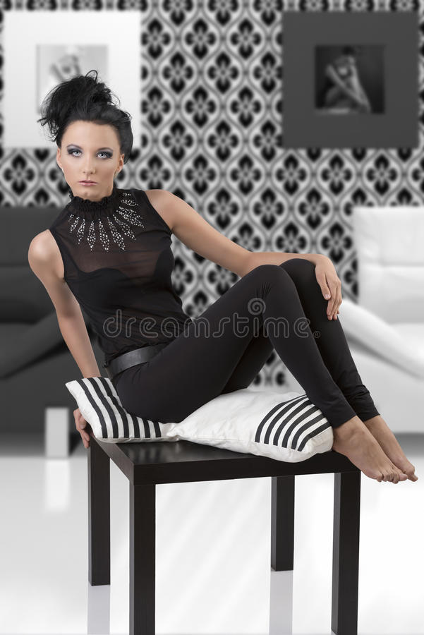 Download Pretty Brunette Is Sitting With Pillows Stock Photo - Image: 26606070