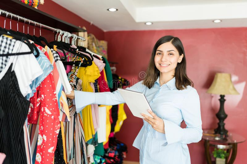 Pretty Brunette Supervisor Working At Boutique royalty free stock photo