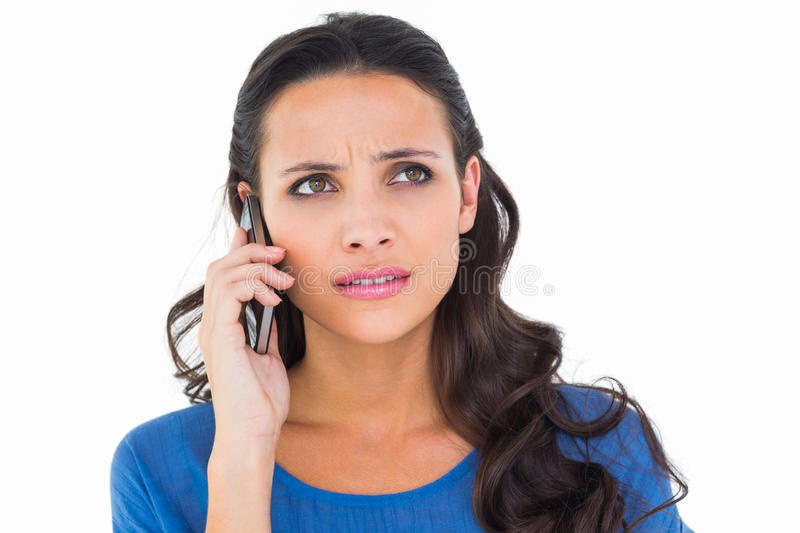 Pretty brunette talking on the phone royalty free stock images