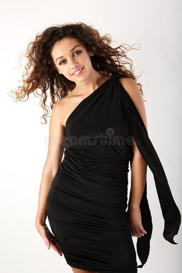 Pretty brunette woman in the black dress. royalty free stock photos