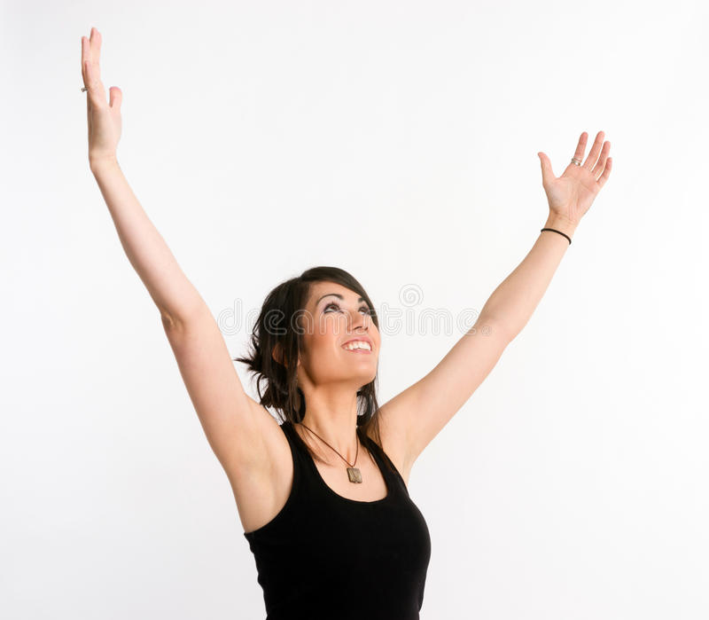 Pretty Brunette Woman Holds Arms Outstretched Jubilant Looking Up stock images