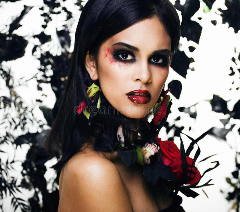 Pretty brunette woman with rose jewelry, black and red, bright m. Ake up a vampire closeup red lips, halloween concept stock images