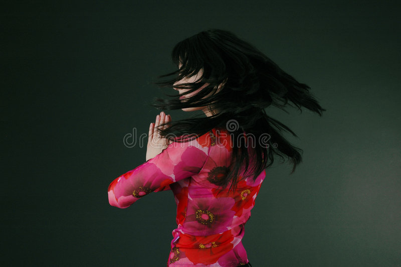 Pretty brunette woman spinning royalty free stock photos