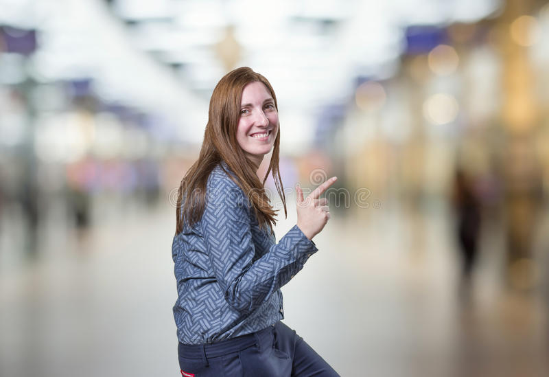 Pretty business woman dancing over blur background stock images