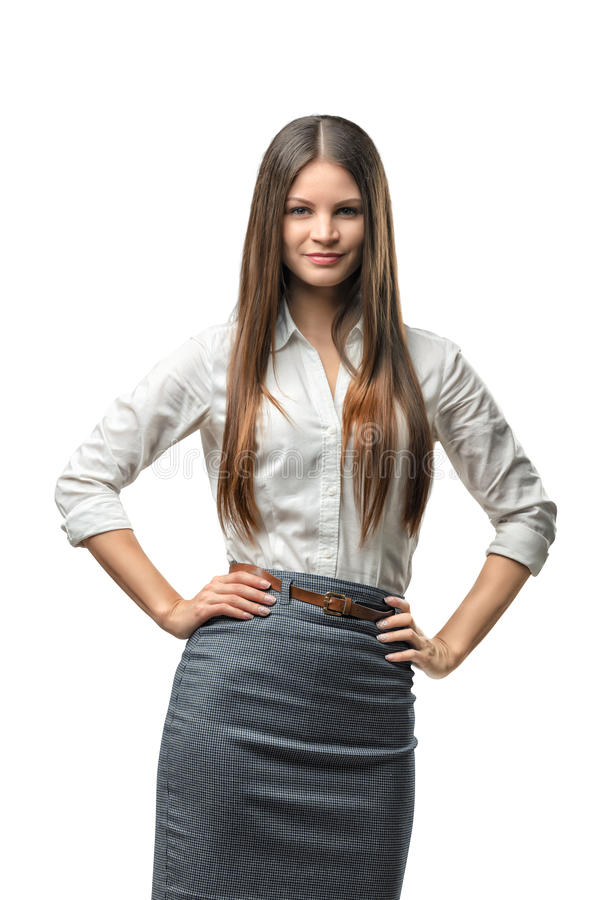 Pretty business woman looks directly at the camera pleasantly smiling royalty free stock photography