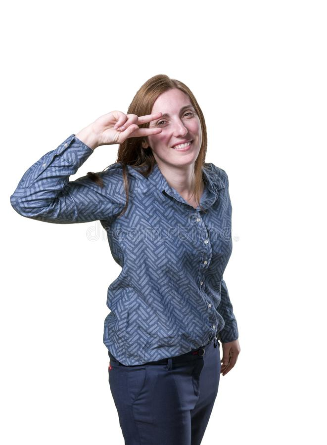 Pretty business woman making victory gesture over white background.  royalty free stock photos